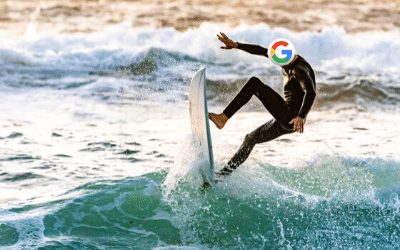surfer riding waves with Google logo